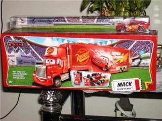 THE HIT DISNEY PIXAR CARS 2 MACK TRUCK HAULER WITH LIGHTNING McQUEEN